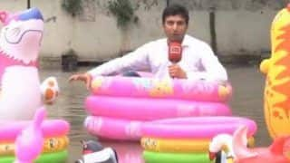 Pakistani Reporter Hilariously Sits in an Inflatable Plastic Tub To Cover Monsoon From Water-Filled Street