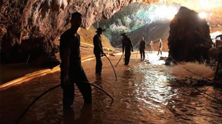 Hero doctor emerges from Thai cave to discover his father has died