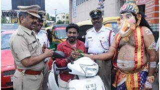 Bengaluru Traffic Police Deploys 'Lord Ganesha' to Handover Helmets For Road Safety
