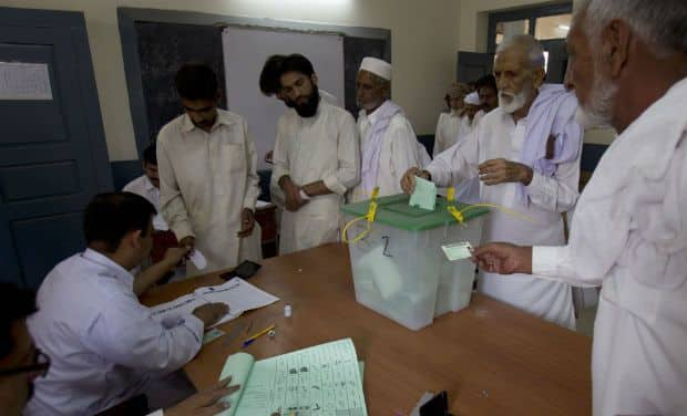 Pakistan's incumbent party reject 'rigged' election result as Imran Khan takes lead