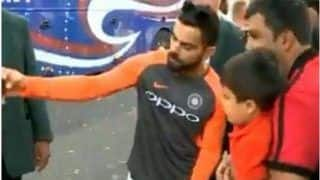 India vs England 4th Test: Virat Kohli Makes His Young Fan's Day by Clicking a Selfie Outside Trent Bridge Stadium in Nottingham---Watch Video