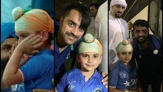 Asia Cup 2018 Super Four, India vs Afghanistan: Crying Indian Kid Consoled by Rashid Khan And Mohammad Shahzad Shows Friendship Between Two Nations -- PIC