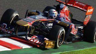 Button wins in Japan, Vettel seals championship