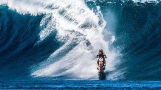 Robbie Maddison goes surfing on his KTM dirt bike in Tahiti: Watch Video