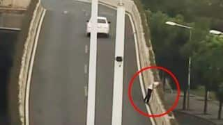 China: Man Jumps Off Expressway to Escape Drunk Driving Test – Watch Viral Video