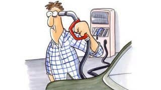 Impact of petrol price hike and plunging dollar on Indian Auto Industry