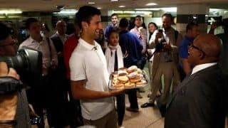 US Open Champion Novak Djokovic Hands out Donuts to Commuters in New York City