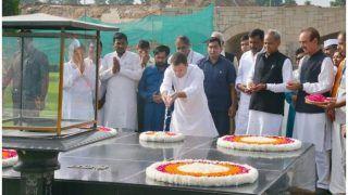 विरोध मार्च से पहले राहुल गांधी ने कैलाश मानसरोवर से लाया जल बापू की समाधि पर चढ़ाया