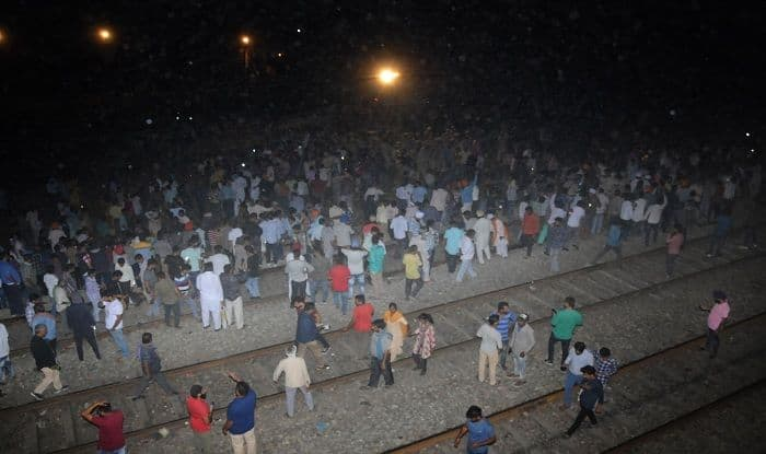 Train kills at least 60 people watching fireworks in India during festival