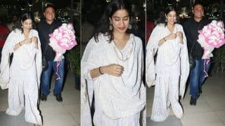 Janhvi Kapoor Can't Stop Blushing at The Airport in Her White Chikankari Suit And a Bouquet of Soft Toys