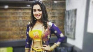 Bhojpuri Hottie Amrapali Dubey Looks Sexy as She Flaunts Her Washboard Abs in Yellow Lehenga - See Picture