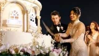Priyanka Chopra And Nick Jonas Cut Their Huge Wedding Cake With a Sword; Check Out Video