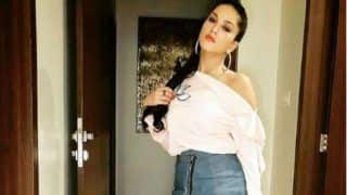 Sunny Leone Looks Super Hot in Short Dress And Red Lips as She Seductively Poses For Camera - See Picture