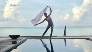 Sushmita Sen Looks Hot in Purple Monokini as She Strikes a Sexy Pose at Picturesque Location - See Picture