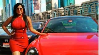 Bhojpuri Bomb, Anjana Singh, Looks Super Hot in Red Mini Dress, Poses With a Red Car. See Sexy Pic