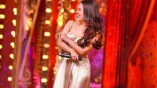 Neha Kakkar Looks Smoking Hot in Metallic Golden Dress as She Laughs Her Heart Out on Comedy Show - See Picture