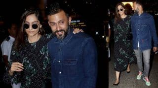 Sonam Kapoor Nails Her Airport Look in Breezy Black Floral Dress by Ganni, Husband Anand Ahuja Looks Equally Complimenting