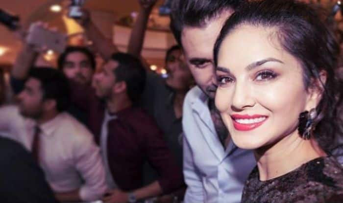Sunny Leone Raises The Temperature in Sexy Black Dress With Hot Red Lipstick- See Picture