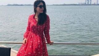 Kareena Kapoor Khan Looks Ready For Summer Posing in Red Maxi Dress Paired With Black Shades