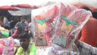 T-Shirts, Pens, Badges With Narendra Modi's Catchy Messages Draw Crowd