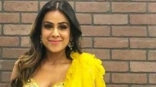 Second Sexiest Woman, Nia Sharma Looks Smoking Hot in Sheer Net Yellow Saree as She Twirls Around Flaunting Her Curvaceous Curves
