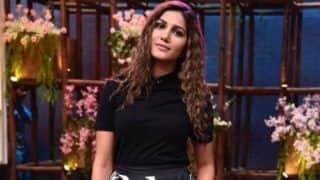 Haryanvi Desi Queen Sapna Choudhary Looks Hot in Black Top And Zebra Printed Skirt With Sexy Curly Hairdo in Her Latest Pictures