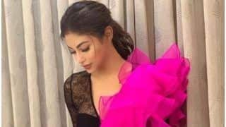 Television Hotshot Mouni Roy Looks Super Sexy in Flurry Black And Pink Gown as She Kickstarts RAW Promotions