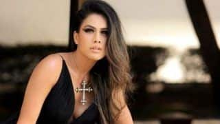 Nia Sharma Looks Sizzling Hot in Sexy Black Dress And Net Gloves as She Strikes Seductive Pose in Latest Picture