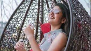 Priya Prakash Varrier Looks Sizzling Hot in Floral Grey Dress as She Relaxes on Swing Chair