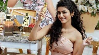 Priya Prakash Varrier Looks Sizzling Hot in Peach Dress And Curly Hair as She Shoots For Perfume Ad