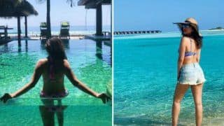 Sophie Choudhary Looks Hot AF in Stripped Blue Bikini While Basking in The Sun as She Vacays in Maldives