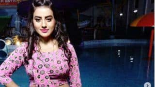 Bhojpuri Hot Bomb Akshara Singh Sizzles in a Pink Ensemble Dress in Poolside Picture