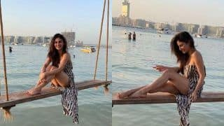 Mouni Roy Looks Hot as She Poses on a Swing in The Ocean, See Pictures