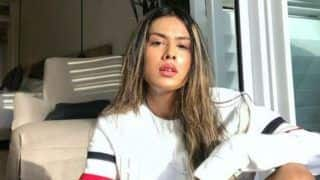 Nia Sharma Turns up The Heat in White Shirt And Ripped Shorts in Latest Sun-kissed Pictures