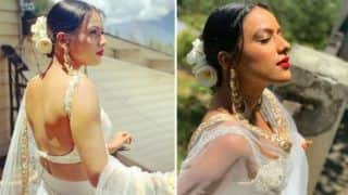 Television's Dusky Beauty Nia Sharma Looks Hot AF in Sheer White Lehenga as She Flaunts Her Sexy Curves