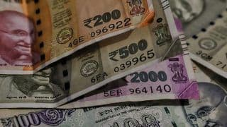 Rupee Ends Flat at 69.26 a Dollar Ahead of RBI Policy Decision