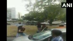 VIDEO: कार सवार लड़की का रोड पर हंगामा, रॉड से युवक पर ऐसे कर दिया हमला