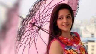 Bhojpuri Hot Bomb Monalisa's Easy Breezy Picture in Pink Dress And Matching Umbrella is What You Can't Miss