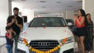 Bhojpuri Hot Bomb Monalisa Jumps With Excitement After She Buys Audi Along With Hubby Vikrant Singh Rajput