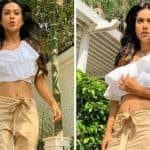 Nia Sharma 'Don't Mind The Tan' as She Walks in The Sun Like a Boss in White Crop Top And Beige Trousers
