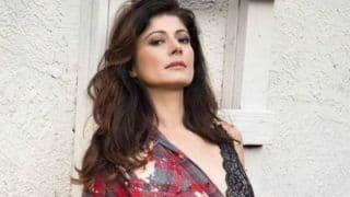 Pooja Batra Looks Smoking Hot in Red Shirt And Denim Shorts in Her Latest Sultry Picture