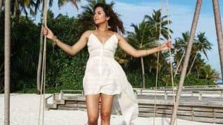Punjabi Hottie Sargun Mehta Looks Her Sexiest Best in White Dress as She Poses on Lounger in Maldives