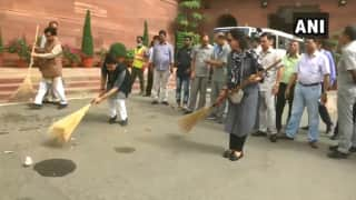 BJP MP Hema Malini Sweeps Road in Parliament Premises Under 'Swachh Bharat Abhiyan' Initiative | Watch
