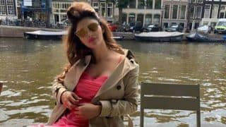 Mouni Roy Sizzles in Sexy Satin Pink Dress And Boots as She Vacays in Amsterdam