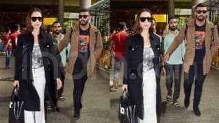 Arjun Kapoor Protects Malaika Arora at Mumbai Airport as They Return From Melbourne - Viral Video