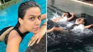 Nia Sharma Sets Her Fans Heart Aflutter in Hot Black Monokini as She Takes Water Bed Massage in The Pool