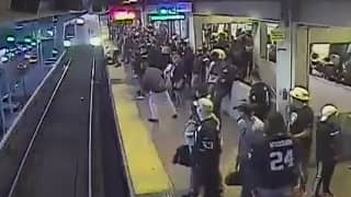 Watch: Dramatic Video Shows Man Being Pulled From Tracks Seconds Before Train Arrives