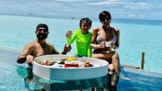 Mandira Bedi Looks Hot in Sexy White Bikini as She Indulges in Delicacies Along With Husband And Daughter