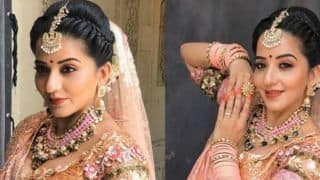 Bhojpuri Hot Bomb Monalisa Sizzles in Her Latest Bridal Look in Peach Shimmery Lehenga