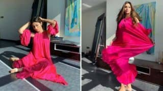 Mouni Roy Dons Bright Pink Dress And Looks Uber Hot as She Twirls Around - See Pics